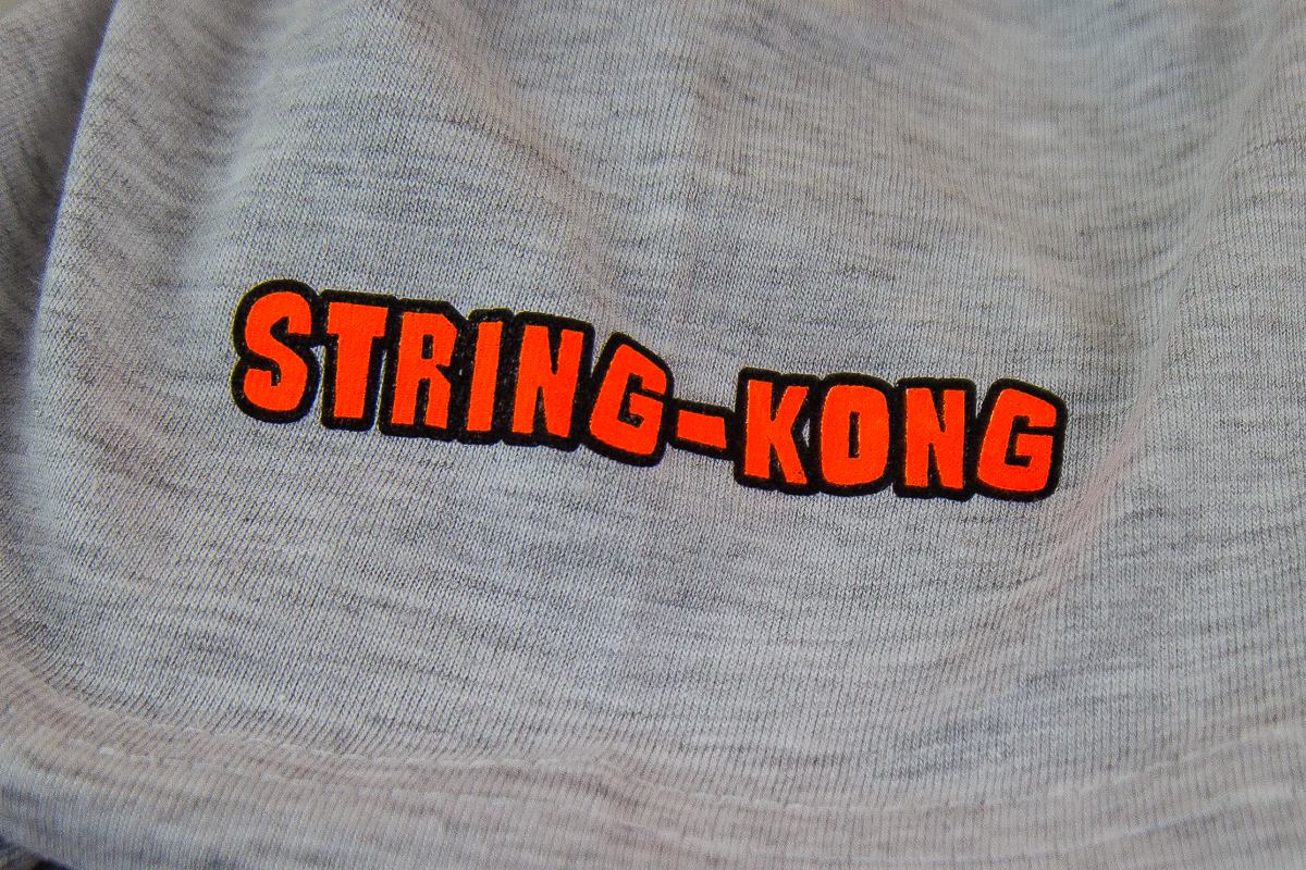 String-Kong Slow Play T-shirt logo
